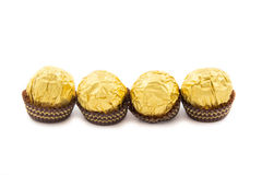 Sweet chocolate balls with almond wrapped in gold foil paper Royalty Free Stock Photos