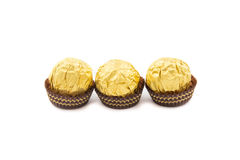 Sweet chocolate balls with almond wrapped in gold foil paper Stock Photography