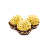 Sweet chocolate balls with almond wrapped in gold foil paper Royalty Free Stock Image