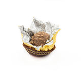 Sweet chocolate balls with almond wrapped in open gold foil paper Royalty Free Stock Photo