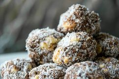 Sweet chocolate balls made with coconut royalty free stock image