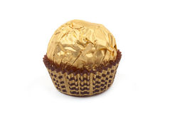Sweet chocolate bonbon in golden foil Royalty Free Stock Images