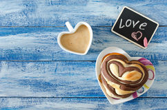Sweet chocolate buns Heart on the table Royalty Free Stock Image