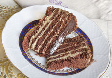 Sweet chocolate cake. With cream on a plate Stock Photography