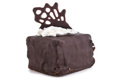 Sweet chocolate cake decorate with dark chocolate ship the image Royalty Free Stock Photos