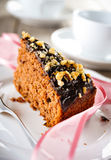 Sweet chocolate cake. Chocolate cake with roasted walnuts Royalty Free Stock Images