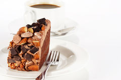 Sweet chocolate cake topping almond nut with coffee Stock Image