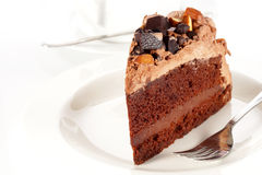 Sweet chocolate cake topping almond nut with coffee Stock Images