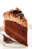 Sweet chocolate cake topping with chocolate and almond nut Royalty Free Stock Images