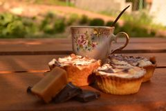 Sweet cakes on wooden table Royalty Free Stock Images