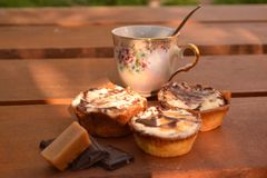 Sweet cakes on wooden table Stock Photography