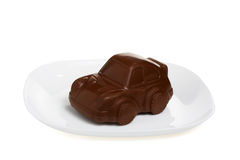 A sweet chocolate car on white plate Stock Photos