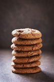 Sweet chocolate cookies or biscuit on rustic background Stock Image
