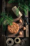 Sweet chocolate cookies with nuts and spruce. On wooden table royalty free stock photos