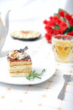 Sweet chocolate dessert with tea and napkin Royalty Free Stock Images
