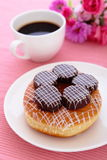 Sweet chocolate donut with a cup of coffee Stock Images