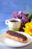 Easter still life with choclate eclair and flowers Stock Photography