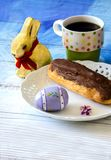 Easter still life with choclate eclair Royalty Free Stock Photos
