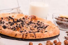 Sweet chocolate pizza with cookies. Royalty Free Stock Photography