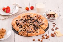 Sweet chocolate pizza with cookies. Stock Image