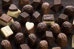 Sweet chocolate pralines. An assortment of sweet chocolate pralines Stock Images