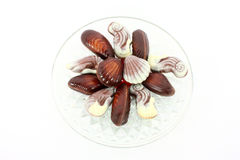 Sweet chocolate shellfish on glass plate Royalty Free Stock Photography