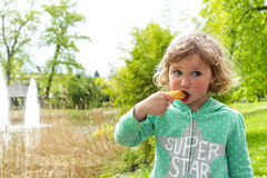 Sweet chocolate snack, Luxembourg. Girl with sweet chocolate snack, Luxembourg Stock Photography