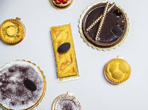 Sweet choice. Overhead shot of different sweets, pies and baked specialities Royalty Free Stock Image