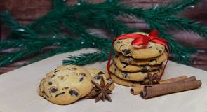Christmas cookies. Sweet Christmas cookies for New Year holiday with chocolate and red bow Stock Photos