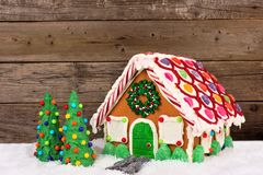 Christmas gingerbread house against a wood background royalty free stock images