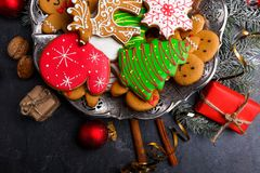 The sweet Christmas gingerbreads with icing in the form of a Christmas tree, and many others. Indoors. stock image