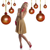 Sweet christmas girl in golden dress Royalty Free Stock Photo