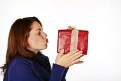 Sweet Christmas Present. Cute Cheerful Girl Kissing Her Christmas Present Stock Image