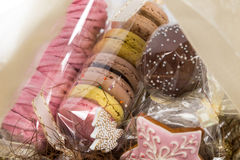 Sweet christmas present in basket with pastry Stock Photo