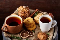 Christmas teatime with oatmeal, chocolate biscuits, and spices, on wooden background, close-up, selective focus. royalty free stock images