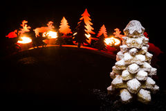 Sweet christmas tree. Cookies Christmas tree with red candle, pines and reindeer Stock Photos