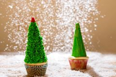 Sweet Christmas trees on a background of falling snow. stock images