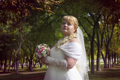 Sweet chubby bride looking above Stock Images