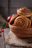 Sweet cinnamon bun rolls or kanelbullar homemade. Delicious dessert with spice on vintage woonde table. Traditional swedish baked pastry stock photography