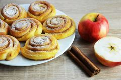 Sweet cinnamon rolls with apples Stock Photos