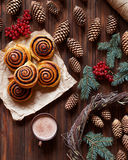 Sweet Cinnamon rolls buns with a cup of cocoa. Christmas baking. Kanelbulle swedish dessert. Top view. stock photo