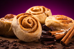 Sweet cinnamon rolls. And ingredients Royalty Free Stock Photos