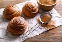 Sweet cinnamon rolls. On wooden table stock photos