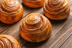 Sweet cinnamon rolls. On wooden table Royalty Free Stock Images