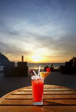 Sweet cocktail on sunset beach. Drink sweet cocktail on sunset beach Stock Image