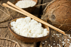 Sweet coconut rice in half coconut shell Stock Image