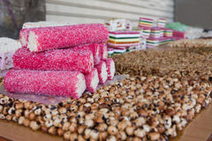 Sweet coconut rolls piled on a snacks stand Royalty Free Stock Images