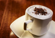Sweet coffee with cream and chocolate flakes Stock Image