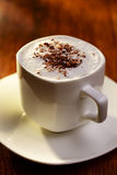 Sweet coffee with cream and chocolate flakes Royalty Free Stock Photography