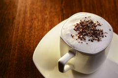 Sweet coffee with cream and chocolate flakes Royalty Free Stock Photos